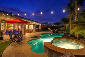 The backyard party lights are on a dimmer to brighten up the pool area at night or dim it down for