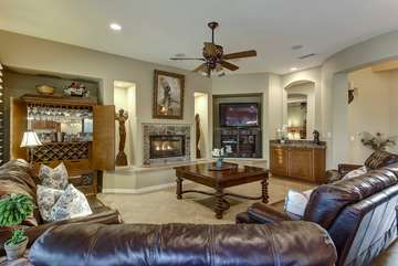 Plenty of living room seating on big cozy couches. Wet bar