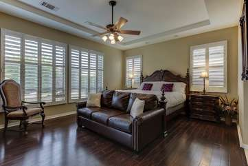 The master bedroom has all wood floors and its own access to the pool area.  Bedroom 1