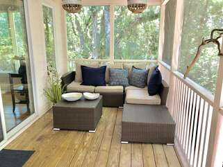 Cozy seating area on the screened porch