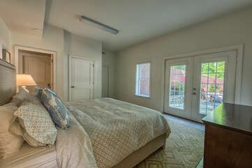 Lower level bedroom with a king size bed and luxurious bedding.