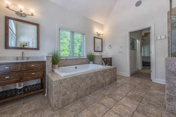 Master bath featuring garden tub, stand alone shower with dual shower heads and double sinks.