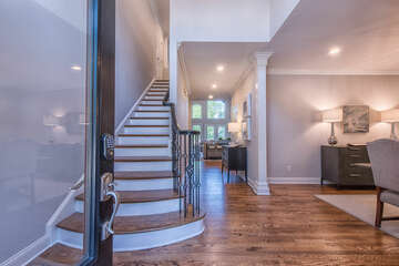 Welcoming entry with natural wood floors