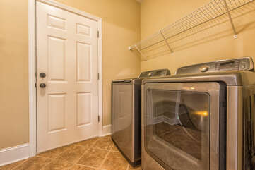 Main level laundry - with garage and lower level access.