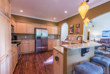 Open kitchen, providing lots of cooking counter space, with bar seating.