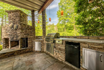 Outdoor fireplace, perfect for making smores and enjoying cool nights on the lake.  Built in grill, dishwasher and sink - a luxurious outdoor kitchen for guests to cook up a meal!
