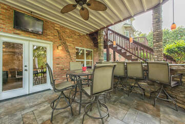 Plenty of outdoor seating, bar seating included, right off the game room.  Outdoor TV