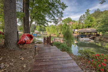 Wooded path and stairs down to the dock, kayak for guests to enjoy.