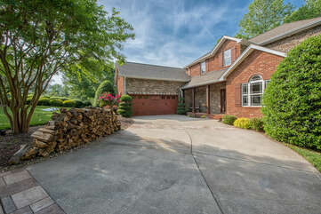 Plenty of driveway space, wood for the outdoor fireplace, and a 2 car garage!