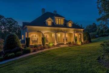 Southern style home with multiple house length patios and decks.