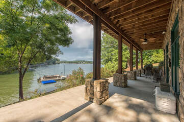 Lower level patio overlooking the lake! Bar top seating and chair seating for taking in lake views!