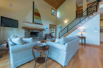 Main level living room - featuring 2 story plus ceilings, open concept living.