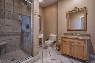 Lower level full bath with stand alone shower - easy access from lake/outdoors.