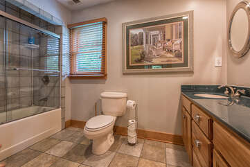 Upstairs full bath - double sinks, bath/shower combo.