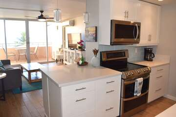 Kitchen opens into living area