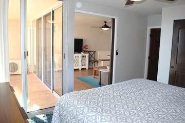 Slider door separated bedroom and living area