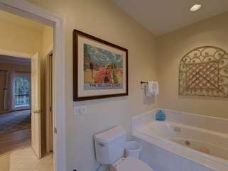 Master Ensuite with garden tub and walk-in shower, separate vanity area with walk-in closet