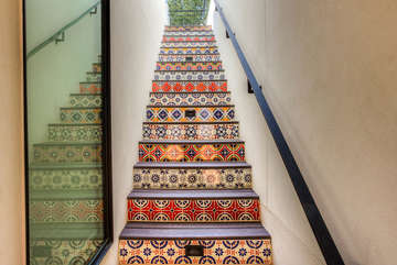 This vibrant tile staircase leads up to the rooftop deck