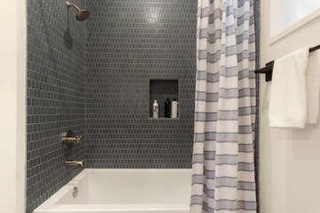 Enjoy the deep soaking tub/shower