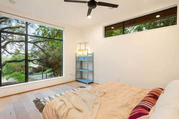 Wake up to a lovely view of the live oak from the master bedroom.