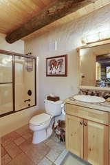 Full bathroom by main entry