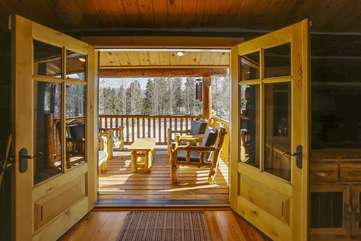 Covered deck off of the kitchen with amazing views