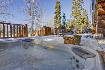 Large custom hot tub built into the rear deck