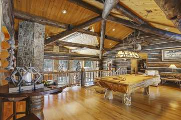 Upper loft game room with hand made pool table