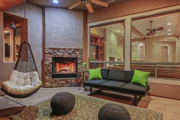 The outdoor fireplace is a favorite spot with its swanky furniture
