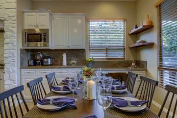 Plenty of table settings for your event and a desk in the back corner provides a nice work area