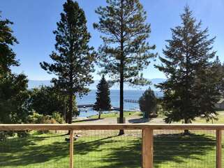 Lakeshore Retreat lawn and deck view