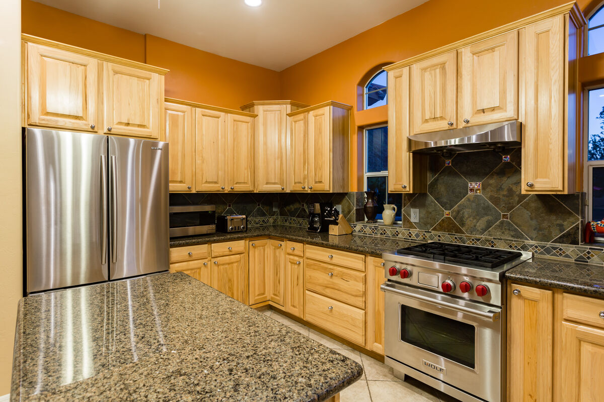 Gourmet Kitchen with Stainless Steel Appliances, Granite Countertops and Plenty of Cabinet Space!