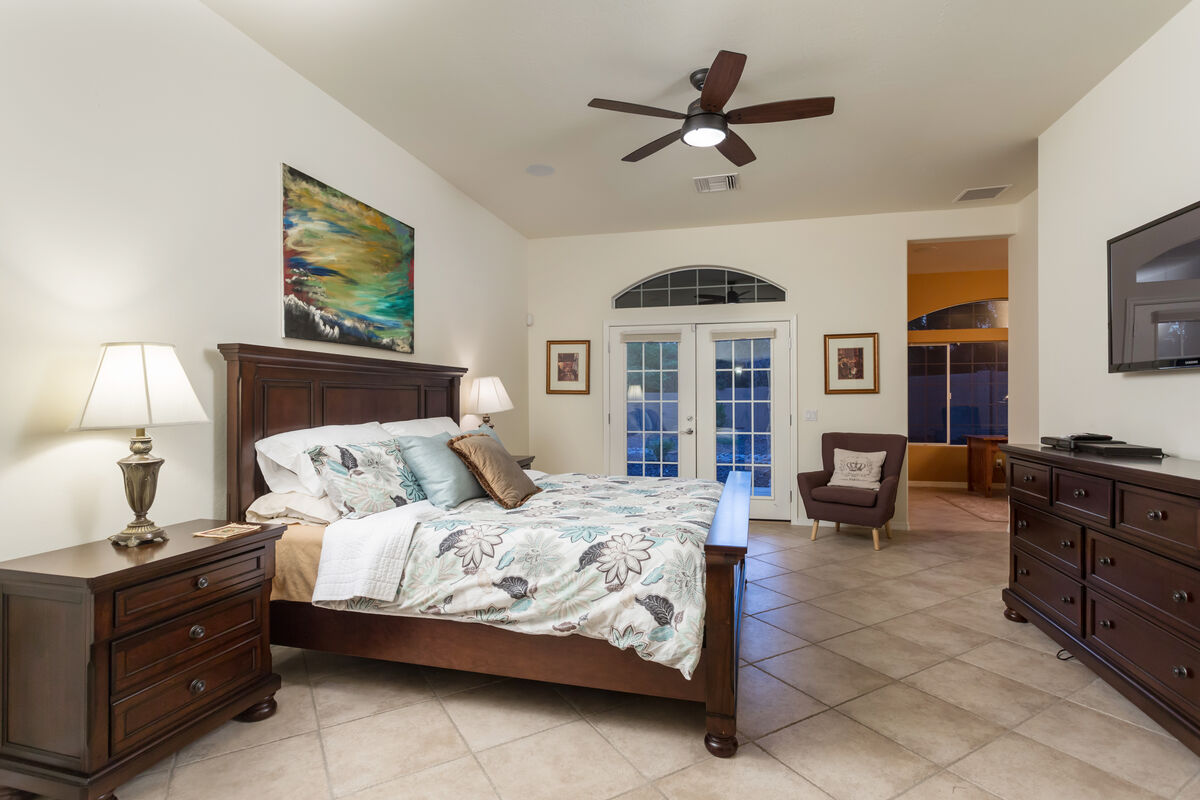 Master Suite has a King Sized Bed, HD Smart TV,  Attached Office, Attached Master Bath & French Doors Leading to Patio Area.