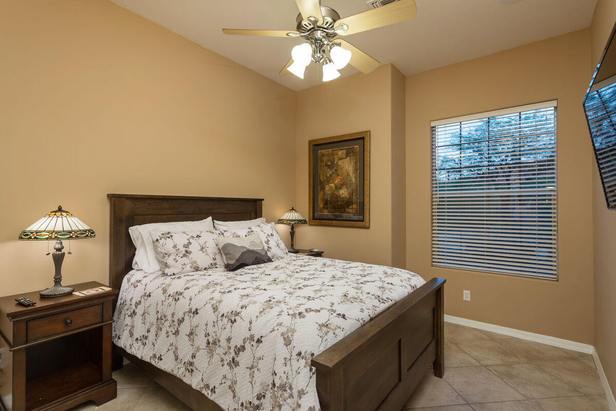 Second Guest Bedroom - Queen Sized Bed w/ 2 Nightstands, Closet and a Wall Mounted HD Smart TV.