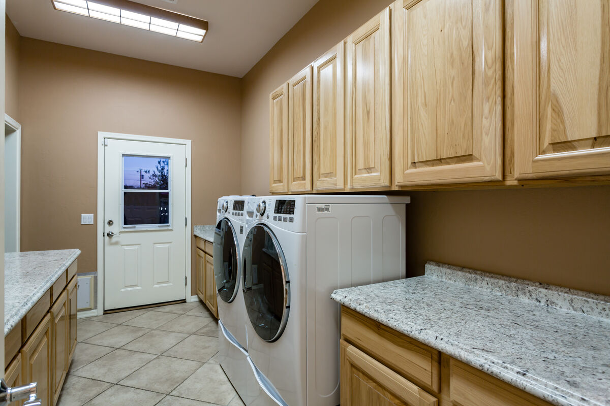 Laundry Room - Leads to Third Bedroom & Bathroom (Private Suite).