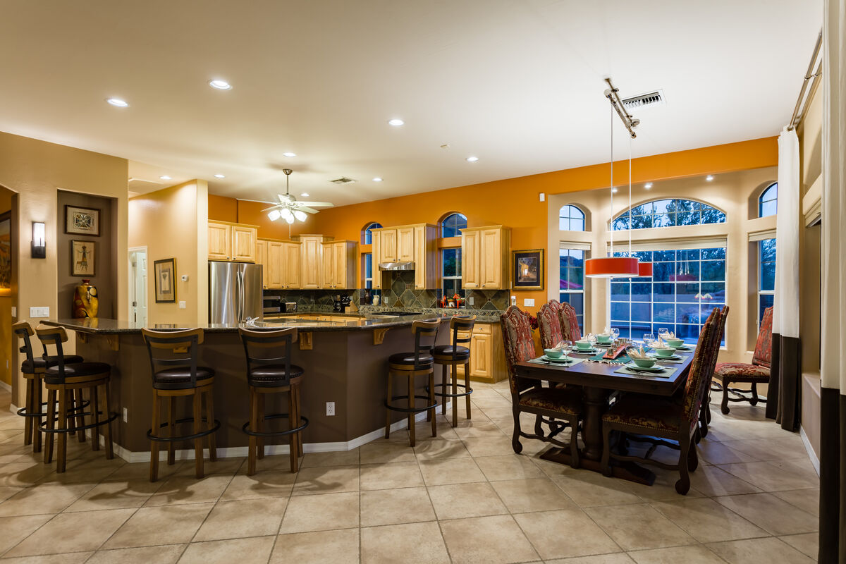 Kitchen, Bar Area and Family Dining Room. 6 barstools and dining table seats up to 8 people.