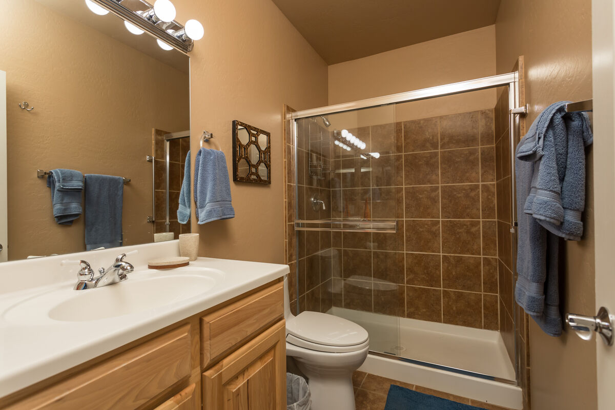 Attached Bathroom of the Third Bedroom, Private Suite. Tub & Shower Combo - Single Vanity.
