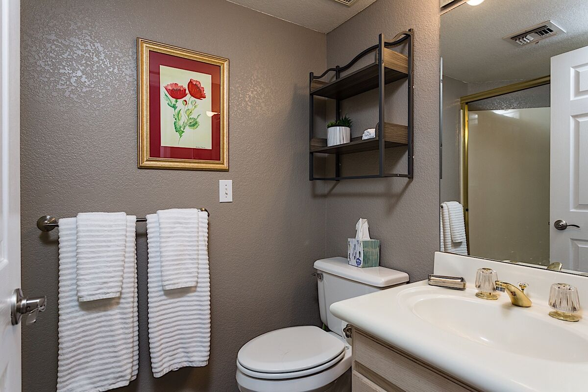 Bathroom attached to the calming retreat bedroom is the perfect place to enjoy some steam in this standing shower