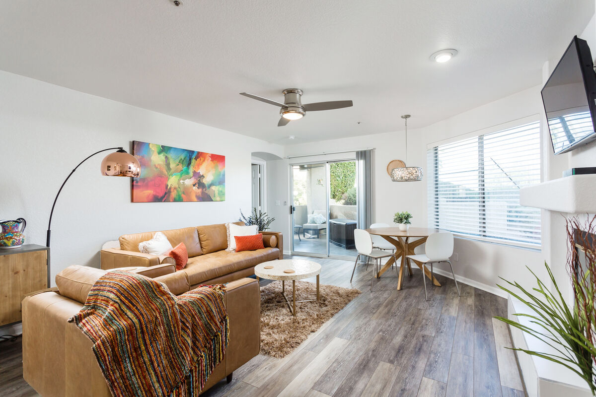 Open living room with patio access to bring the conversation outside as the sun goes down and the heat simmers away
