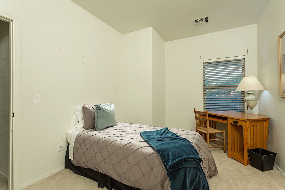 Twin bed with desk area