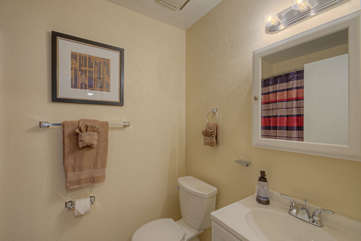 Remodeled second bath has a walk-in shower