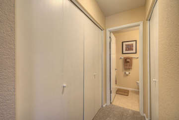 Plentiful closet space in hallway that connects second bedroom to second bathroom