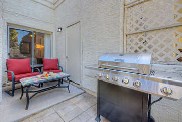 Celebrate the good life on covered patio with comfortable seating and a gas grill for the outdoor chef