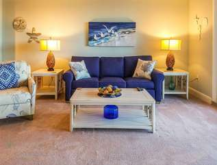 Living room area with queen sleeper sofa