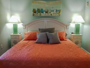 King size bed in bright master bedroom