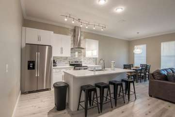 This modern and newly built kitchen with all stainless steal appliances and bar area has a spacious set up with bar seating for 4