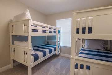 Simplistic, nautical atmosphere in guest, twin bunk bedroom upstairs