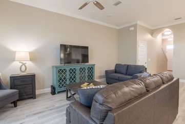 Open living room space with a brand new entertainment center and living room furniture providing plenty of seating for all your companionship