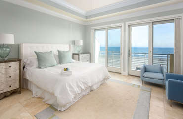 Guest bedroom 3 with ensuite bathroom and private balcony overlooking the beach
