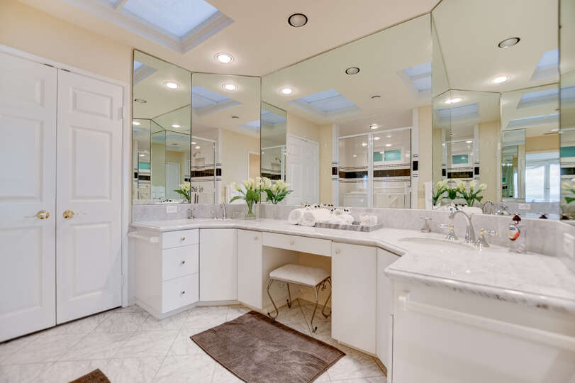 The master suite includes a large bathroom